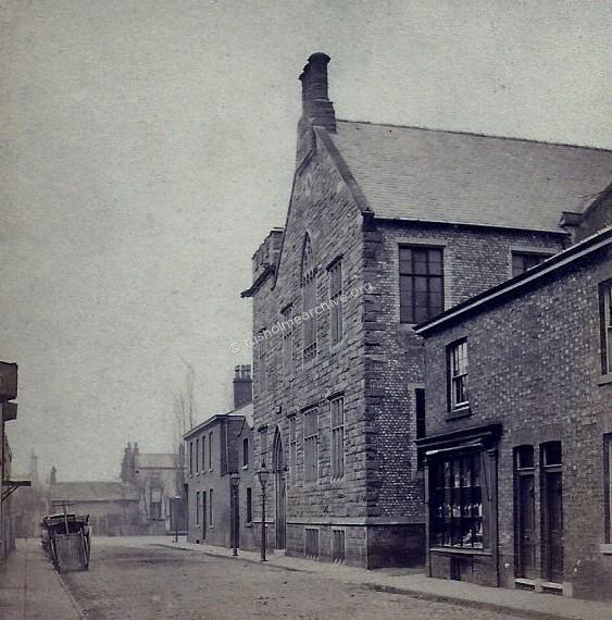 Looking west, Rusholme Public Hall on the right.